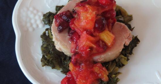 Pork Chop with Cranberry Orange Sauce over Collards